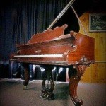 Restored baby grand with French legs